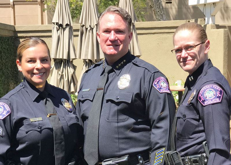 Police department staff in uniform with pink patches