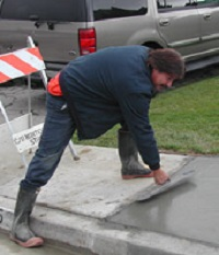 Man Patching Sidewalk